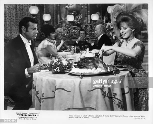Walter Matthau watches in dismay Barbra Streisand eating in a scene from the film 'Hello Dolly!', 1969.