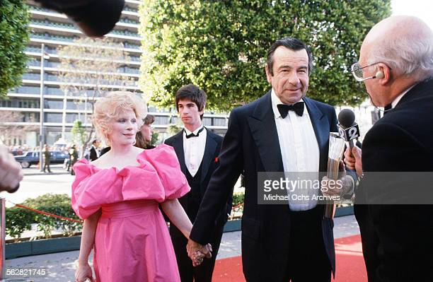 Walter Matthau with wife Carol Grace and son Charlie arrives at the 55th Academy Awards at Dorothy Chandler Pavilion in Los AngelesCalifornia