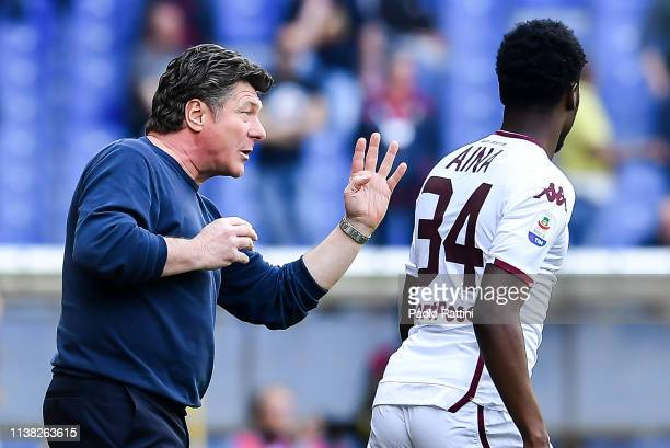 Walter Mazzarri coach of Torino issues some instructions to Temitayo Ola Aina of Torino during the Serie A match between Genoa CFC and Torino FC at...