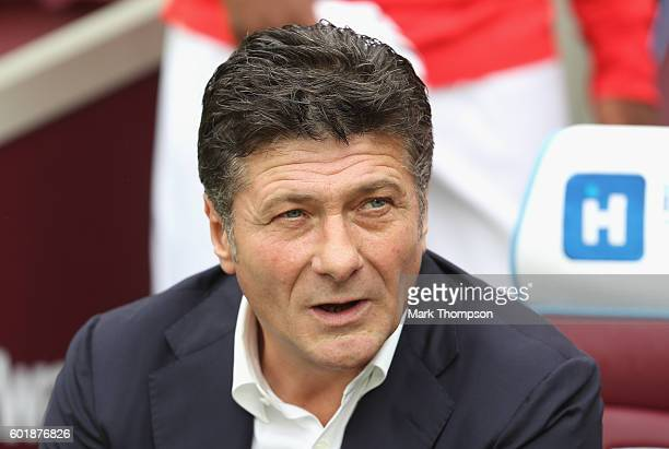 Walter Mazzarri Manager of Watford looks on during the Premier League match between West Ham United and Watford at Olympic Stadium on September 10...