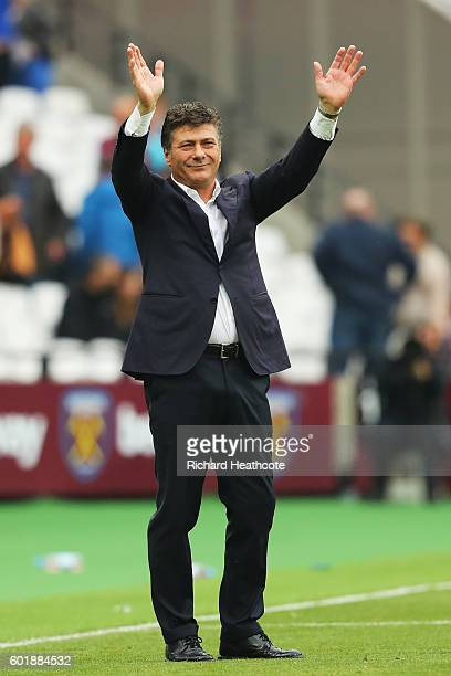 Walter Mazzarri Manager of Watford shows his appreication for the Watford fans during the Premier League match between West Ham United and Watford at...