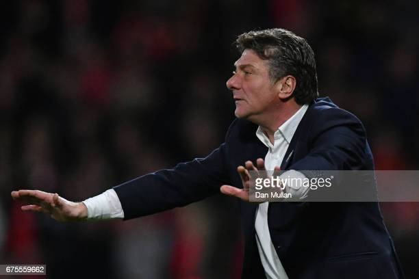 Walter Mazzarri the manager of Watford reacts during the Premier League match between Watford and Liverpool at Vicarage Road on May 1 2017 in Watford...