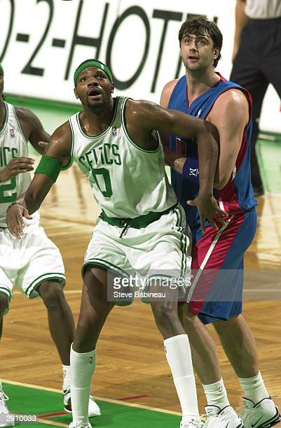 Walter McCarty of the Boston Celtics boxes out Mehmet Okur of the Detroit Pistons January 28 2004 at the Fleet Center in Boston Massachusetts NOTE TO...