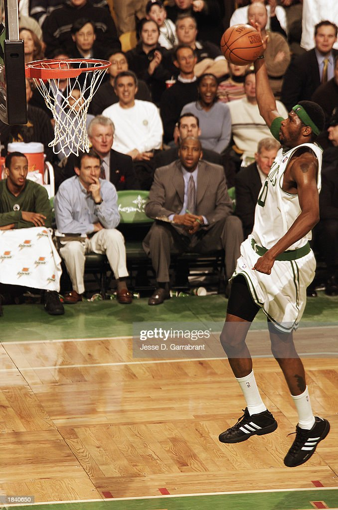 Walter McCarty #0 of the Boston Celtics goes up for a dunk during the NBA game against the Houston Rockets at Fleet Center on February 24, 2003 in Boston, Massachusetts. The Rockets won in overtime 101-95.