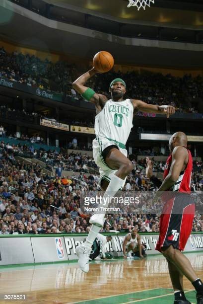 Walter McCarty of the Boston Celtics goes up for a dunk during the game against the Toronto Raptors at the Fleet Center in Boston, Massachusetts on...