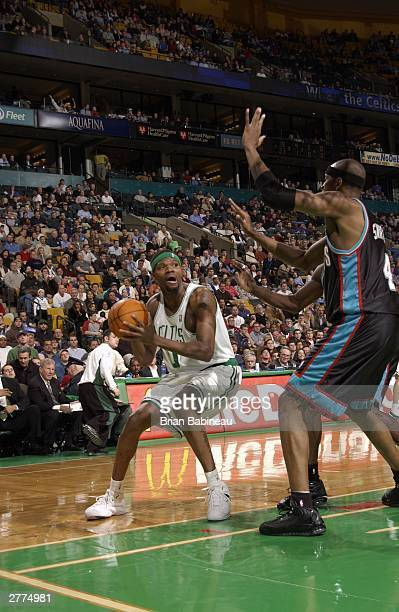Walter McCarty of the Boston Celtics is double teamed against Memphis Grizzlies during the game at the Fleetcenter on December 1 2003 in Boston...