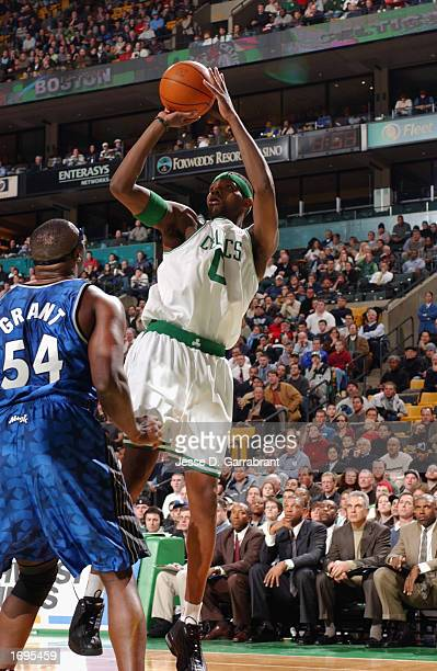 Walter McCarty of the Boston Celtics puts up a shot over Horace Grant of the Orlando Magic during the NBA game at the FleetCenter on December 9 2002...