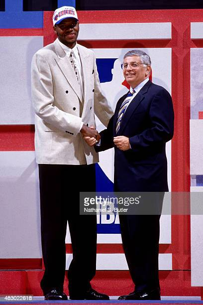 Walter McCarty of the New York Knicks shakes hands with Commissioner David Stern after being selected 19th overall during the 1996 NBA Draft in East...