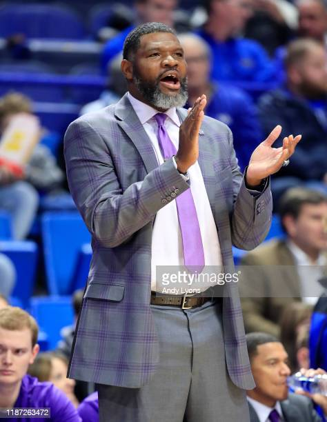 Walter McCarty the head coach of the Evansville Aces gives instructions to his team in the 6764 win over the Kentucky Wildcats at Rupp Arena on...