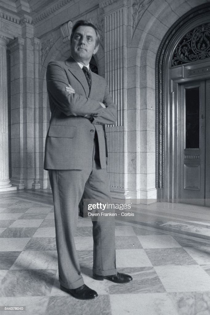 Walter Mondale, Minnesota senator and Jimmy Carter's vice presidential running mate, stands with arms folded at the Senate Chamber in the US Capitol.