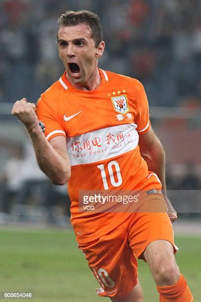 Walter Montillo of Shandong Luneng celebrates a ball during the quarter final match of the AFC Champions League between Shandong Luneng and FC Seoul...