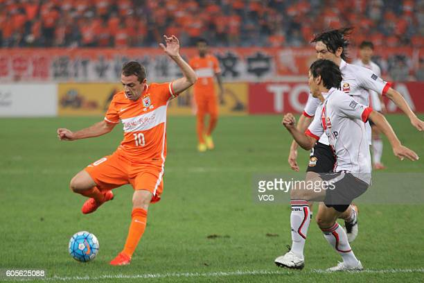 Walter Montillo of Shandong Luneng drives the ball during the quarter final match of AFC Asian Champions League between the Shandong Luneng FC and FC...