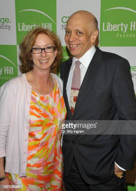 Walter Mosley and guest attend the Liberty Hill's Upton Sinclair Awards Dinner honoring him at Hyatt Regency Century Plaza on May 20, 2010 in Century...