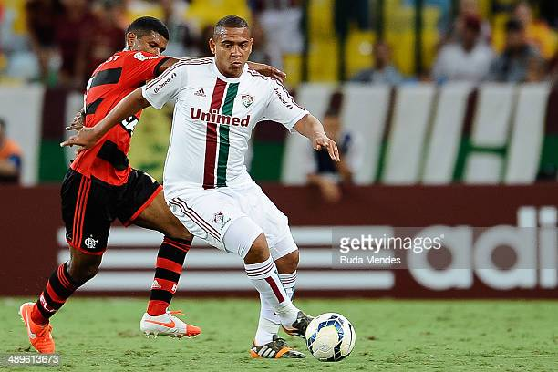 Walter of Fluminense struggles for the ball with Marcio Araujo of Flamengo during a match between Fluminense and Flamengo as part of Brasileirao...