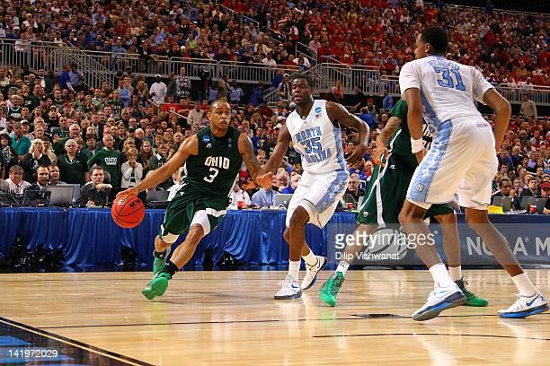 Walter Offutt of the Ohio Bobcats drives against Reggie Bullock and John Henson of the North Carolina Tar Heels during the 2012 NCAA Men's Basketball...