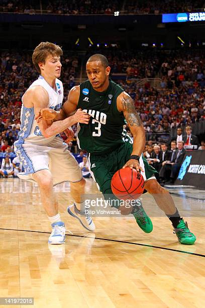 Walter Offutt of the Ohio Bobcats drives against Stilman White of the North Carolina Tar Heels during the 2012 NCAA Men's Basketball Midwest Regional...
