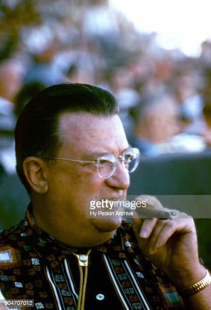Walter O'Malley owner of the Brooklyn Dodgers sits in the crowd during an MLB Spring Training game against the Boston Red Sox circa March 1956 in...