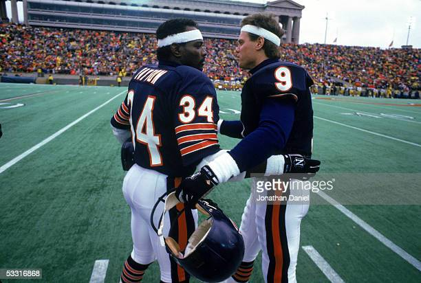 Walter Payton and Jim McMahon of the Chicago Bears greet each other on the sideline during the 1985 NFC Championship game against the Los Angeles...