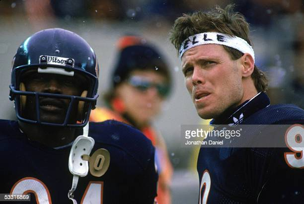 Walter Payton and Jim McMahon of the Chicago Bears look on during the 1985 NFC Championship game against the Los Angeles Rams at Soldier Field on...