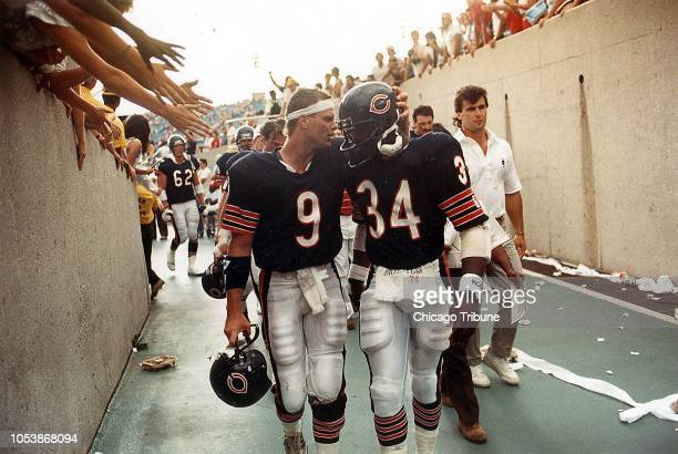 Walter Payton leaves the field with QB Jim McMahon after the Bears beat Tampa Bay at Soldier Field on Sept 8 1985 in the season opener