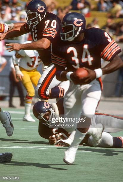 Walter Payton of the Chicago Bears carries the ball against the Washington Redskins during an NFL football game October 3 1976 at Soldier Field in...