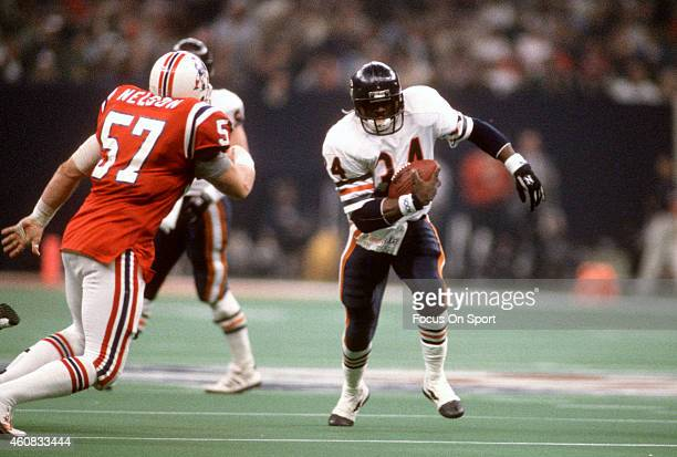 Walter Payton of the Chicago Bears carries the ball against the New England Patriots during Super Bowl XX January 26, 1986 at the Louisiana Superdome...
