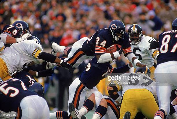 Walter Payton of the Chicago Bears carries the ball as he jumps over the line during a game against the Pittsburgh Steelers