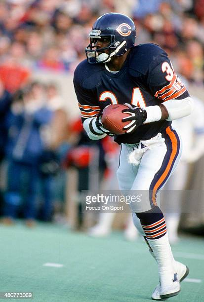 Walter Payton of the Chicago Bears carries the ball during an NFL football game circa 1983 at Soldier Field in Chicago, Illinois. Payton played for...