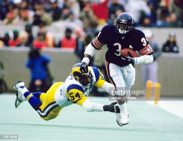 Walter Payton of the Chicago Bears carries the ball during the NFC Championship Game against the Los Angeles Rams on January 12 1986 in Chicago...