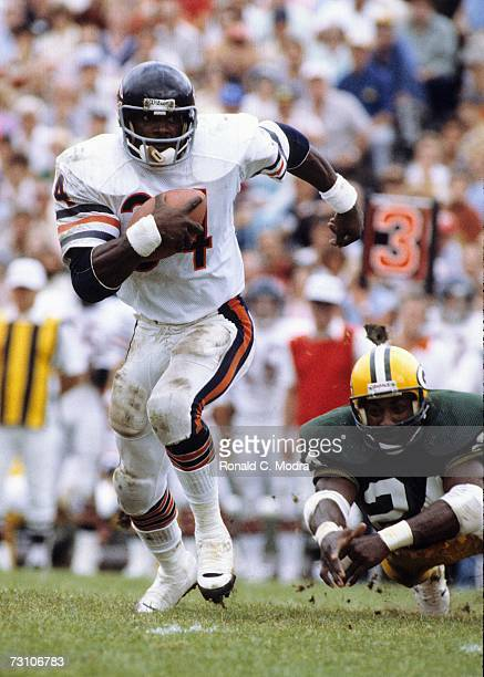 Walter Payton of the Chicago Bears carries the ball in a game against the Green Bay Packers on September 6 l981 in Green Bay Wisconsin