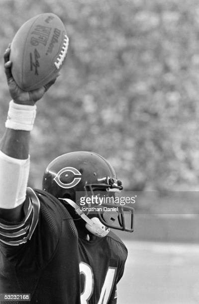 Walter Payton of the Chicago Bears celebrates after breaking Jim Brown's rushing record during the game against the New Orleans Saints at Soldier...
