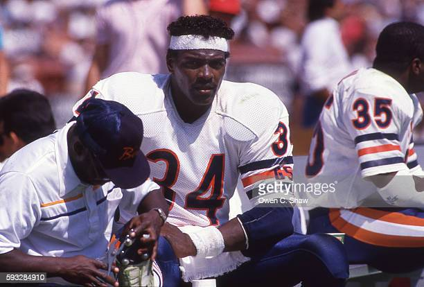 Walter Payton of the Chicago Bears circa 1987 sits on sideline against the Los Angeles Raiders at the Coliseum in Los Angeles, California.