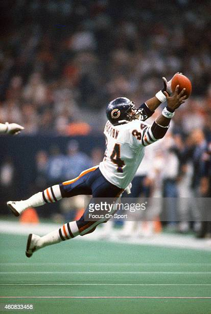 Walter Payton of the Chicago Bears dives for this pass against the New England Patriots during Super Bowl XX January 26 1986 at the Louisiana...