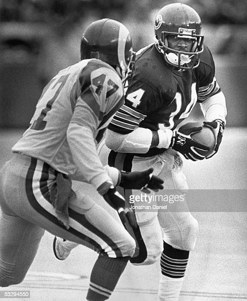Walter Payton of the Chicago Bears heads upfield against LeRoy Irvin of the Los Angeles Rams during the 1985 NFC Championship game at Soldier Field...