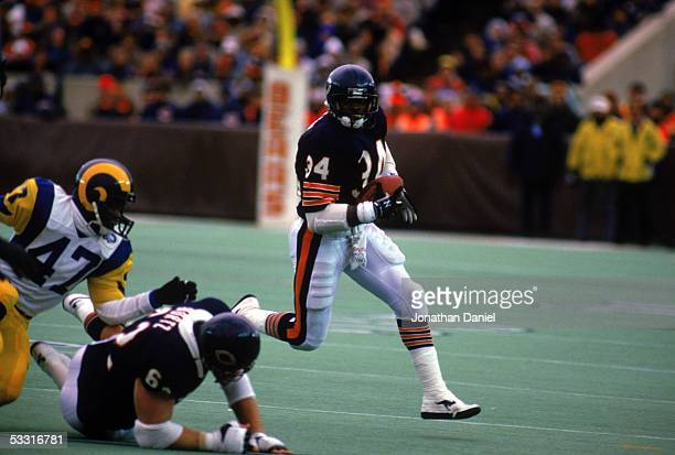 Walter Payton of the Chicago Bears heads upfield against the Los Angeles Rams during the 1985 NFC Championship game at Soldier Field on January 12...