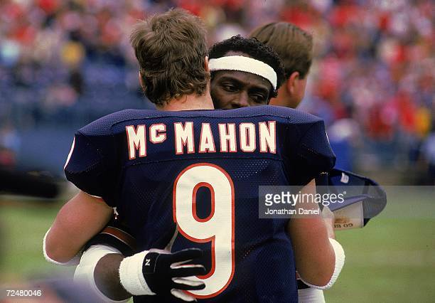 Walter Payton of the Chicago Bears hugs Quarterback Jim McMahon after a game