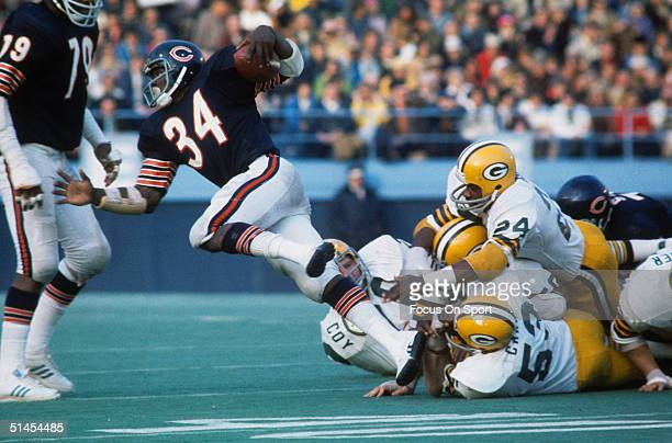 Walter Payton of the Chicago Bears is tackled by the Green Bay Packers.