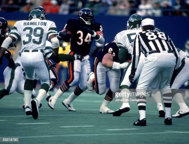 Walter Payton of the Chicago Bears rushes against the New York Jets during the game at Giants Stadium on December 14 1985 in East Rutherford New...