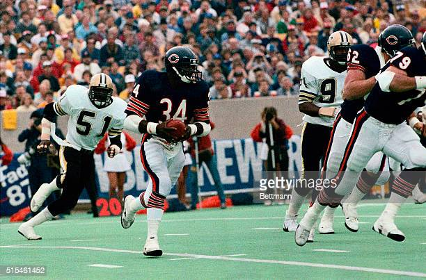 Walter Payton, running back for the Chicago Bears, runs with the football in a game against the New Orleans Saints, when he broke Jim Brown's rushing...
