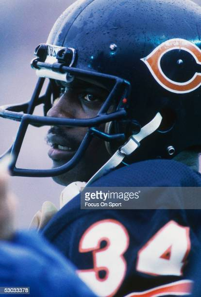 Walter Payton running back for the Chicago Bears sits on the sidelines during a game