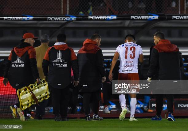 Walter Perez of Huracan leaves the field after being injured during a match between Huracan and Boca Juniors as part of Superliga Argentina 2018/19...