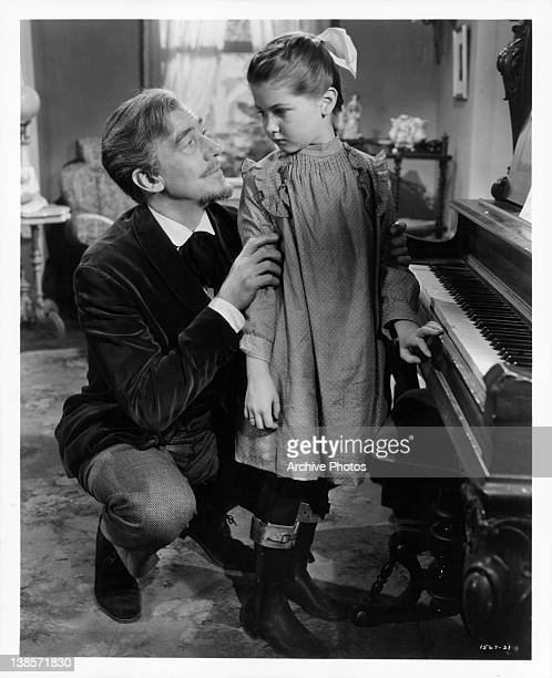 Walter Pidgeon encourages his handicapped daughter Annette Kellerman in a scene from the film 'Million Dollar Mermaid' 1952