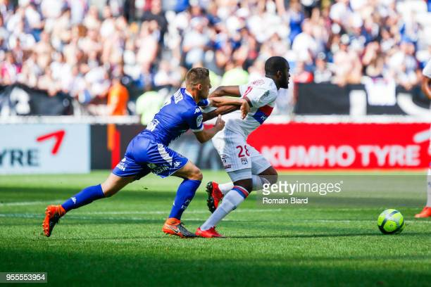 Walter Remi of Troyes and Ndombele Alvaro Tanguy of Lyon during the Ligue 1 match between Olympique Lyonnais and Troyes AC at Parc Olympique on May 6...