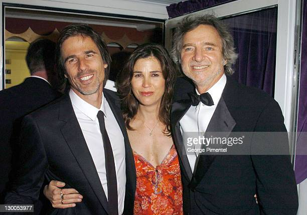 Walter Salles Rebecca Yeldman and Curtis Hanson during 2004 Cannes Film Festival 'Motorcycle Diaries' Party at La Plage Coste in Cannes France