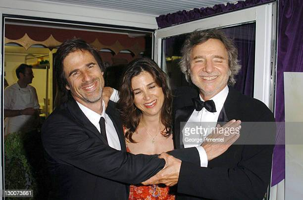 Walter Salles Rebecca Yeldman and Curtis Hanson during 2004 Cannes Film Festival Motorcycle Diaries Party at La Plage Coste in Cannes France