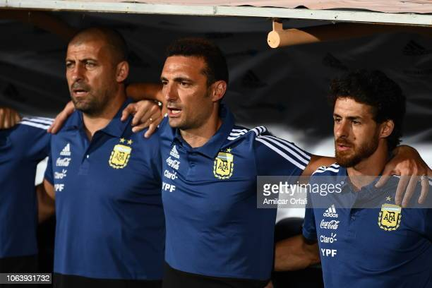 Walter Samuel Lionel Scaloni coach of Argentina and Pablo Aimar sing the national anthem prior a friendly match between Argentina and Mexico at...