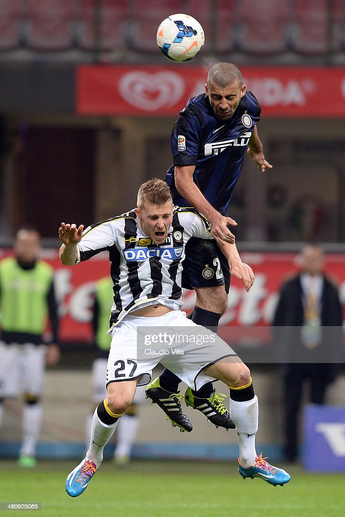 Walter Samuel of FC Inter Milan and Silvan Widmer of Udinese Calcio #27 compete for the ball during the Serie A match between FC Internazionale Milano and Udinese Calcio at San Siro Stadium on March 27, 2014 in Milan, Italy.
