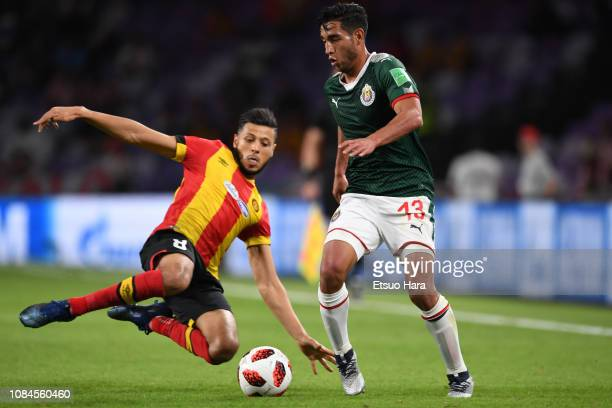 Walter Sandoval of Guadalajara and Anice Badri of Tunis compete for the ball during the match between ES Tunis and CD Guadalajara on December 18 2018...