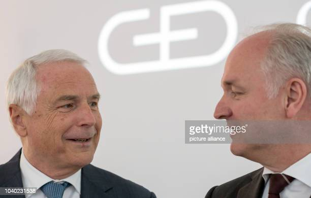 Walter Schlebusch CEO of banknote and securities printing company Giesecke Devrient speaks next to the Chief Financial Officer Peter Zattler at the...