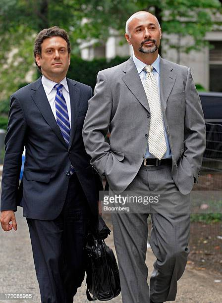 Walter Shimoon a former consultant for Primary Global Research LLC right exits federal court with his attorney Henry Mazurek in New York US on Monday...